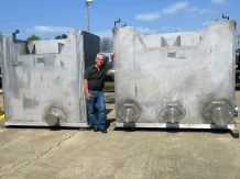 Pat Fink with Domtar's separator water collection tank